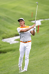 May 5, 2019 - Charlotte, North Carolina, United States of America - Rickie Fowler hits an approach shot on the eighteenth hole during the final round of the 2019 Wells Fargo Championship at Quail Hollow Club on May 05, 2019 in Charlotte, North Carolina. (Credit Image: © Spencer Lee/ZUMA Wire)