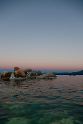"""Tahoe Boulders at Sunrise 9"" - These orange, black, and grey boulders were photographed at sunrise from a kayak near Speedboat Beach, Lake Tahoe."