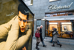 Glass display cabinet for luxury boutique Chopard  on famous shopping street Kurfurstendamm , Kudamm, in Berlin, Germany.