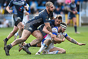 Alex Susino (17) of Featherstone Rovers and Dane Chisholm (7) of Featherstone Rovers tackle Mike Butt (1) of Swinton Lions during the Betfred Championship match between Featherstone Rovers and Halifax RLFC at the Big Fellas Stadium, Featherstone, United Kingdom on 9 February 2020.