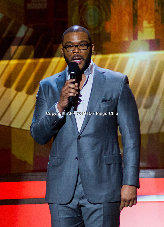 Actor Tyler Perry speaks onstage during a concert, Stevie Wonder: Songs In The Key Of Life - An All-Star GRAMMY Salute, at Nokia Theatre L.A. Live on February 10, 2015 in Los Angeles, California. AFP PHOTO / Ringo Chiu