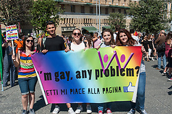 June 27, 2017 - Naples, Italy - Before the parade, the gathering took place at 16 in the Town Hall Square, where representatives of the LGBTQ world were present on stage, as well as other guests, including the godfather of the Parthenon event, Monica Sarnelli, and Mayor Luigi de Magistris. On the facade of Palazzo San Giacomo was also hanging the flag of the event. ''.The intervention of Maria Rosaria Malapena, an activist of Arcigay Naples, and delegated for the area of ??Sexuality and Disability, suffered from spastic tetra paresis..From the Piazza Municipio, then the parade with the head of the commune gonfalone is festive, ironic and engaging as always, to reach Castel dell'Ovo, passing via Toledo, Piazza Trieste and Trento, Piazza del Plebiscito, via Santa Lucia and Parthenope Street. Hundreds of people who once again joined the demonstration to break down the walls of prejudice and discrimination and reiterate that there are inalienable rights that belong to everyone. (Credit Image: © Sonia Brandolone/Pacific Press via ZUMA Wire)