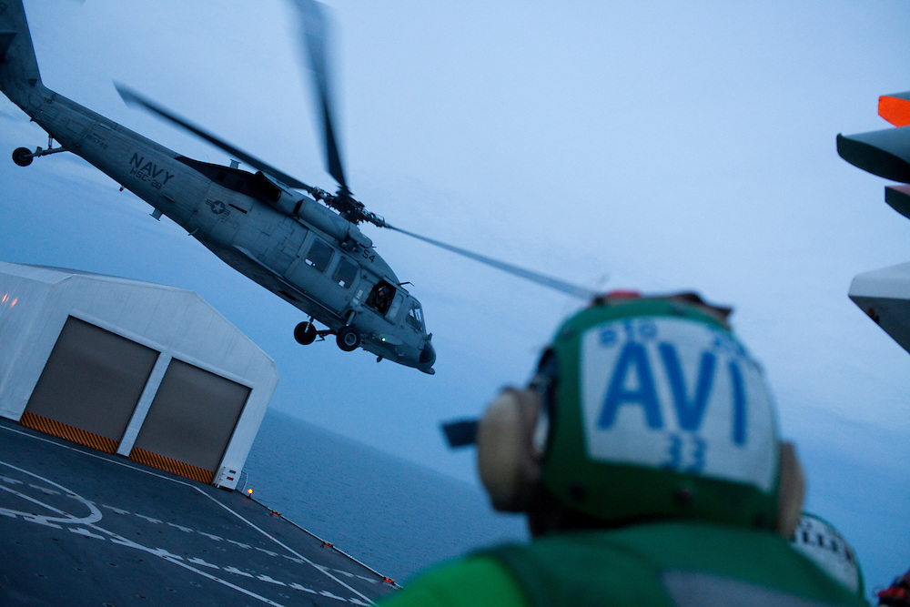 A helicopter takes off from the flight deck of the USNS Comfort, a naval hospital ship, as it makes its way to Haiti to help earthquake survivors on Saturday, January 16, 2010 in the Chesapeake Bay.