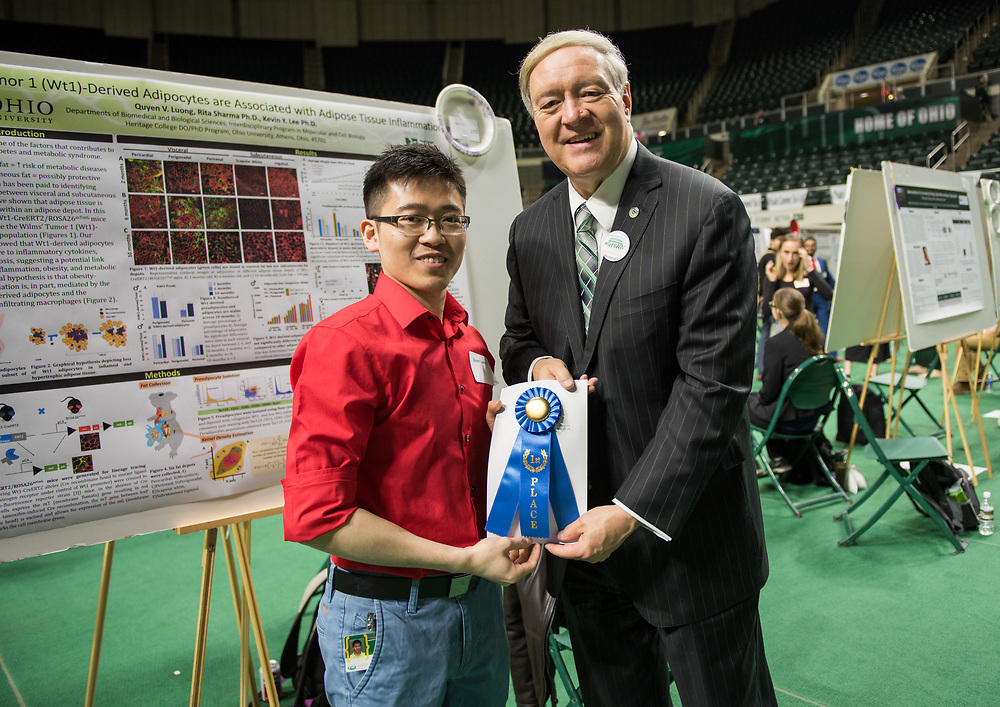 Quyen Luong poses for a picture with Ohio University President Duane Nellis during the 2018 Student Research Expo.