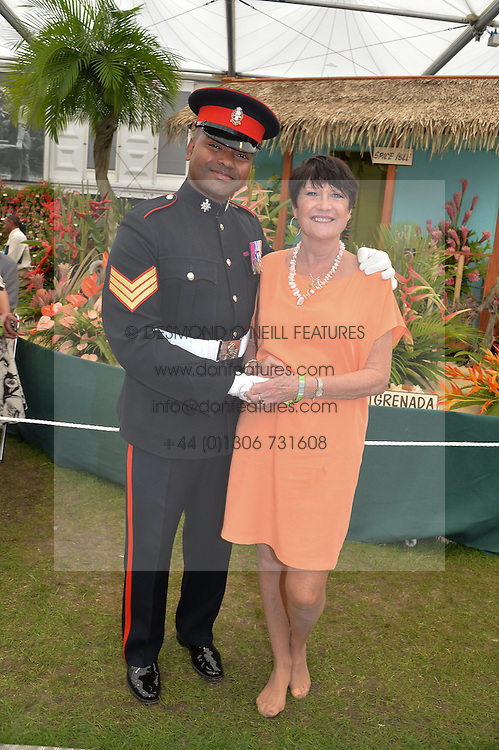 JOHNSON BEHARRY VC and Singer SANDIE SHAW at the 2014 RHS Chelsea Flower Show held at the Royal Hospital Chelsea, London on 19th May 2014.