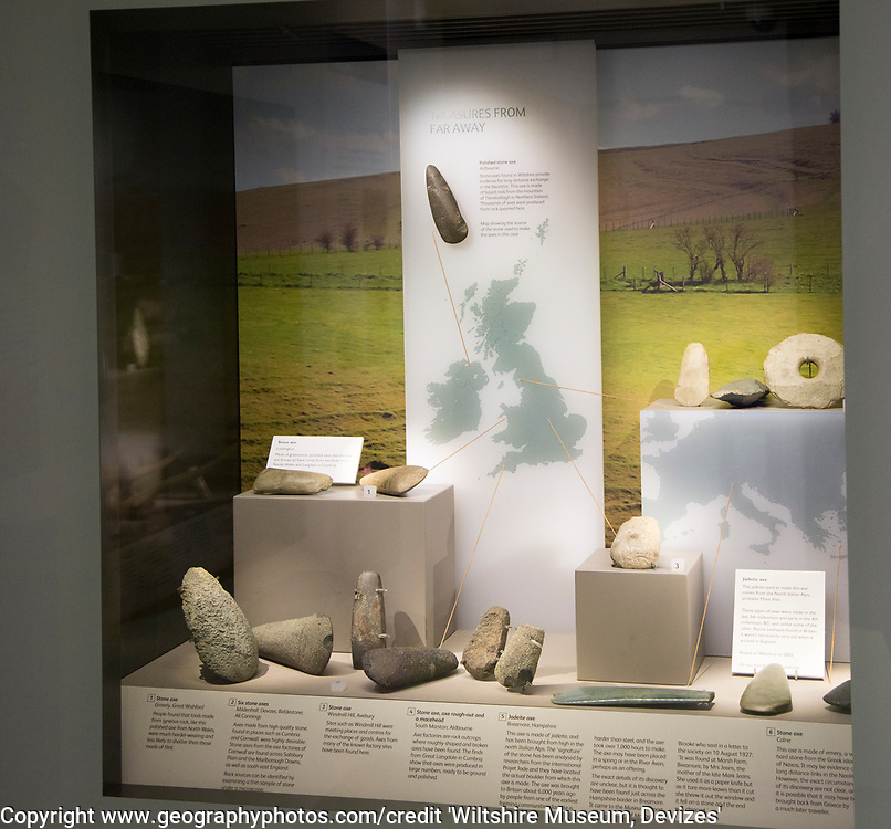 Display of Neolithic trade items, including stone and jadeite axes. With permission of Wiltshire Museum, Devizes, England, UK