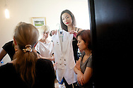 A contestant for the Miss Universe China Pageant  is fitted with clothing for a photo shoot at a training camp for contestants in Beijing, China on Thursday, June 23, 2011.   The training camp was created by cosmetics businesswoman and Chinese-American television personality Yue-Sai Kan's to give China, which has never won a Ms. Universe Contest, a cpotential contender in the upcoming beauty pagent.
