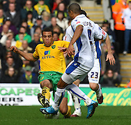 Norwich - Saturday March 27th, 2010:  Jermaine Beckford of Leeds and Darel Russell of Norwich in action during the Coca Cola League One match at Carrow Road, Norwich. (Pic by Paul Chesterton/Focus Images)