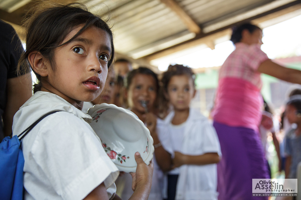 A girl waits to get served lunch at the primary school in the town of Coyolito, Honduras on Wednesday April 24, 2013.