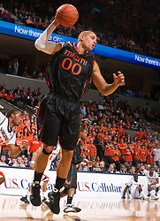 Miami (FL) forward Jimmy Graham (00) grabs a rebound against UVA.  The Virginia Cavaliers fell to the Miami Hurricanes 62-55 at the John Paul Jones Arena on the Grounds of the University of Virginia in Charlottesville, VA on February 26, 2009.