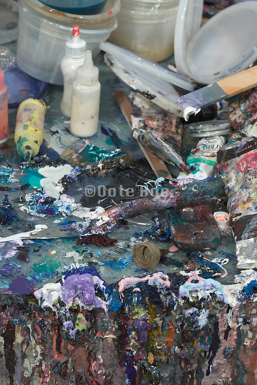 detail of the table with paint in an artist studio