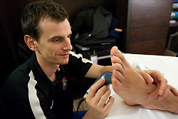Physiotherapist Urban Komac of Slovenian National Ice Hockey team in a massage room in the hotel Holiday Inn at IIHF 2011 World Championship Slovakia, on May 4, 2011 in Bratislava, Slovakia. (Photo By Vid Ponikvar / Sportida.com)