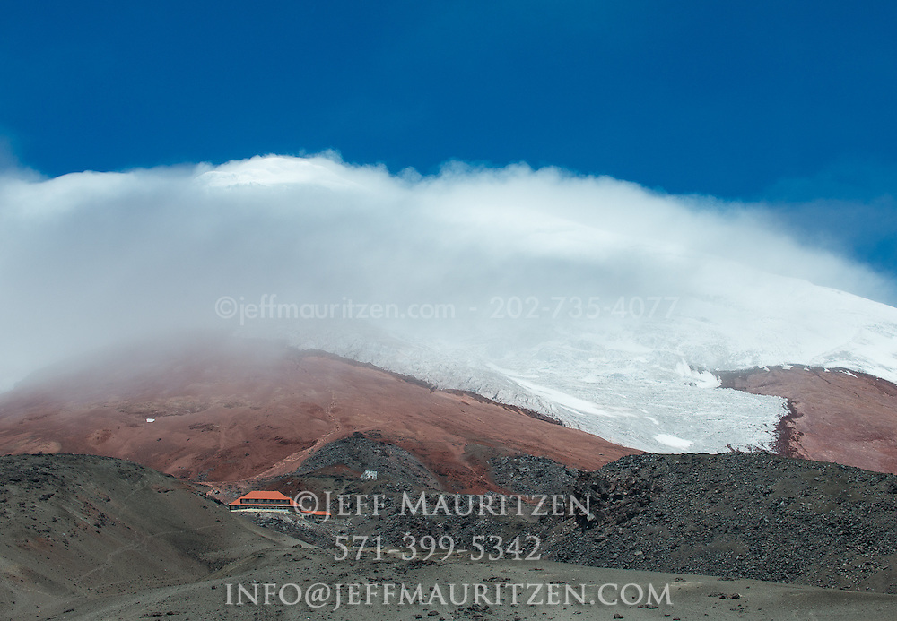Clouds billow across the slopes of Cotopaxi volcano in Ecuador, one of the highest active volcanoes in the world.