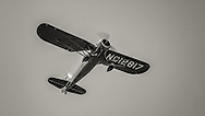 Stinson Model O in flight at the Nortwest Antique Airplane Club flyin at Scapoose, OR.