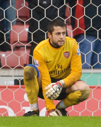 STOKE, ENGLAND - Sunday, January 24, 2010: Arsenal's goalkeeper Lukasz Fabianski looks dejected as Stoke City score the third goal during the FA Cup 4th Round match at the Britannia Stadium. (Photo by David Rawcliffe/Propaganda)