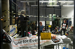 © under license to London News Pictures.  23/11/2010 A student puts up a banner the night before (Tuesday) national demonstrations over the UK . University of Plymouth students occupy a room in the University in protest against the proposed rise in fees. Picture credit should read: David Hedges/London News Pictures.