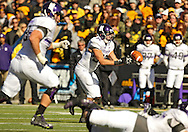October 26 2013: Northwestern Wildcats running back Mike Trumpy (32) can't pull in a backwards pass resulting in a fumble during the fourth quarter of the NCAA football game between the Northwestern Wildcats and the Iowa Hawkeyes at Kinnick Stadium in Iowa City, Iowa on October 26, 2013. The ball was recovered by Iowa Hawkeyes defensive back Desmond King (14) and Iowa defeated Northwestern 17-10 in overtime.