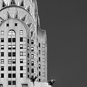 Black and white photograph of the Chrysler Building in New York City. The art deco building was designed by architect William Van Alen.