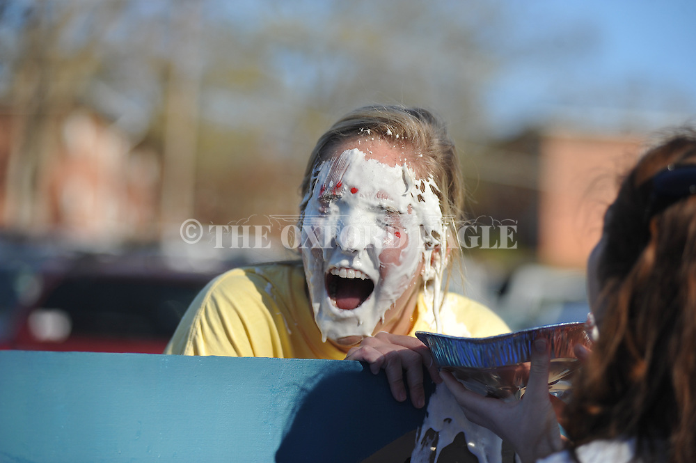 University of Mississippi Pi Beta Phi sorority member Shelby Shelton takes a pie to the face during a sorority fundraiser, in Oxford, Miss. on Wednesday, April 9, 2014. (AP Photo/Oxford Eagle, Bruce Newman)