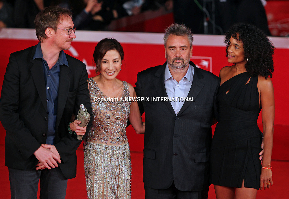"""DAVID THEWILS, MICHELLE YEOH, LUC BESSON  AND VIRGINIE BESSON-SILLA.attend the premiere of """"The Lady"""" at the 6th Rome International Film Festival, Rome, Italy_27/10/2011.Mandatory Credit Photo: ©Ciambelli Sestini/NEWSPIX INTERNATIONAL..**ALL FEES PAYABLE TO: """"NEWSPIX INTERNATIONAL""""**..IMMEDIATE CONFIRMATION OF USAGE REQUIRED:.Newspix International, 31 Chinnery Hill, Bishop's Stortford, ENGLAND CM23 3PS.Tel:+441279 324672  ; Fax: +441279656877.Mobile:  07775681153.e-mail: info@newspixinternational.co.uk"""