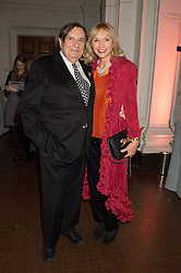 BARRY HUMPHRIES and LIZZIE SPENDER at a dinner to celebrate Sir David Tang's 20 year patronage of the Royal Academy of Arts and the start of building work on the Burlington Gardens wing of the Royal Academy held at 6 Burlington Gardens, London on 26th October 2015.