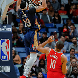 Jan 26, 2018; New Orleans, LA, USA; New Orleans Pelicans forward Anthony Davis (23) dunks over Houston Rockets guard Eric Gordon (10) during the first quarter at the Smoothie King Center. Mandatory Credit: Derick E. Hingle-USA TODAY Sports