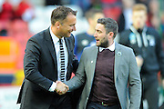 Derby County manager Darren Wassall and Bristol City manager Lee Johnson shake hands before the Sky Bet Championship match between Bristol City and Derby County at Ashton Gate, Bristol, England on 19 April 2016. Photo by Graham Hunt.