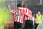 Dan Holman celebrates his 3rd goal during the Vanarama National League match between Cheltenham Town and Woking at Whaddon Road, Cheltenham, England on 12 March 2016. Photo by Antony Thompson.