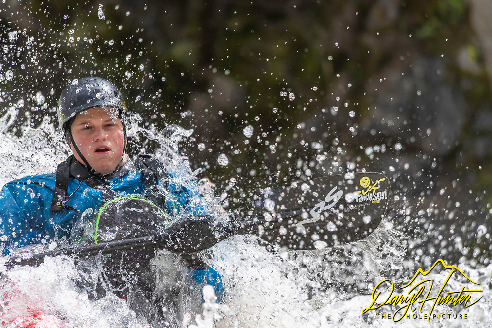 A kayaker very immersed in his sport on the Payette River of southwest Idaho
