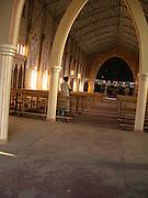 Rwanda - A woman prays alone in a church in Butare a town in the south of Rwanda.