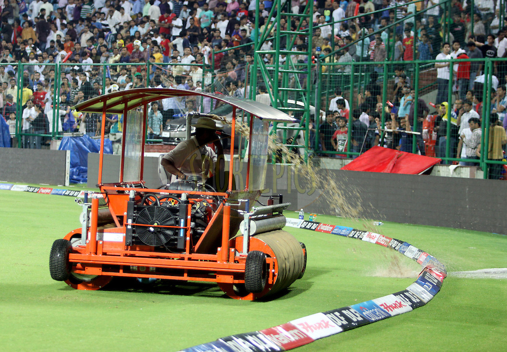 Ground Staff Work as it rains during match 68 of the Indian Premier League ( IPL ) Season 4 between the Delhi Daredevils and the Pune Warriors India held at the Feroz Shah Kotla Stadium in Delhi, India on the 21st May 2011..Photo by Sandeep Shetty/BCCI/SPORTZPICS.