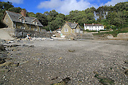 Beach and white cottages at village of Durgan, Cornwall, England, UK