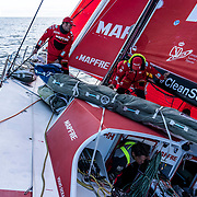 Leg 11, from Gothenburg to The Hague, day 03 on board MAPFRE, Antonio Cuervas-Mons and Rob Greenhalgh moving sails, Joan Vila going out from the hatch . 23 June, 2018.