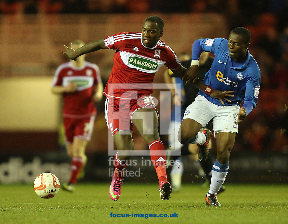Picture by Paul Gaythorpe/Focus Images Ltd +447771 871632.02/04/2013.Ishmael Miller of Middlesbrough and Gabriel Zakuani of Peterborough United during the npower Championship match at the Riverside Stadium, Middlesbrough.