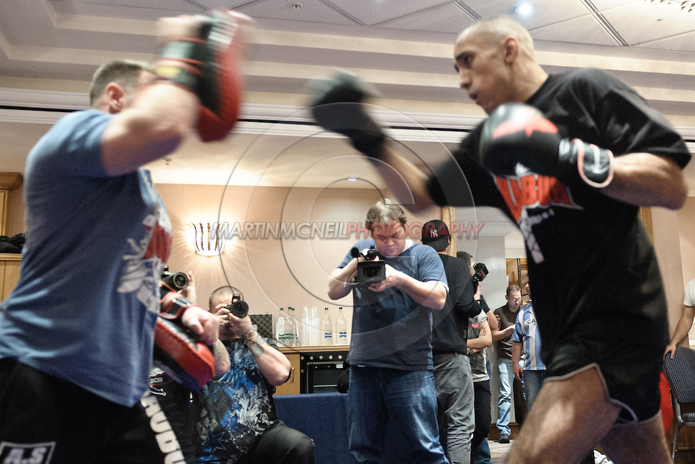 BIRMINGHAM, ENGLAND, NOVEMBER 2, 2011: Terry Etim (right) works on his striking at the media open work-out sessions inside the Hilton Hotel on November 2, 2011.