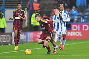 Freddie Sears (20) Ipswich Town and Huddersfield Town midfielder Jonathan Hogg (6) during the EFL Sky Bet Championship match between Huddersfield Town and Ipswich Town at the John Smiths Stadium, Huddersfield, England on 21 January 2017. Photo by Ian Lyall.