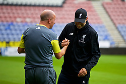 WIGAN, ENGLAND - Friday, July 14, 2017: Wigan Athletic's new manager Paul Cook shakes hands with Liverpool's manager Jürgen Klopp before a preseason friendly match at the DW Stadium. (Pic by David Rawcliffe/Propaganda)