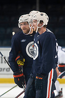 KELOWNA, BC - SEPTEMBER 22:  Connor McDavid #97 and Leon Draisaitl #29 of the Edmonton Oilers stand on the ice during practice at Prospera Place on September 22, 2019 in Kelowna, Canada. (Photo by Marissa Baecker/Shoot the Breeze)