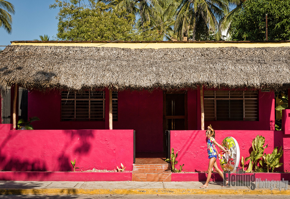 Young girl walking down the street in Bucerias, Nayarit, Mexico