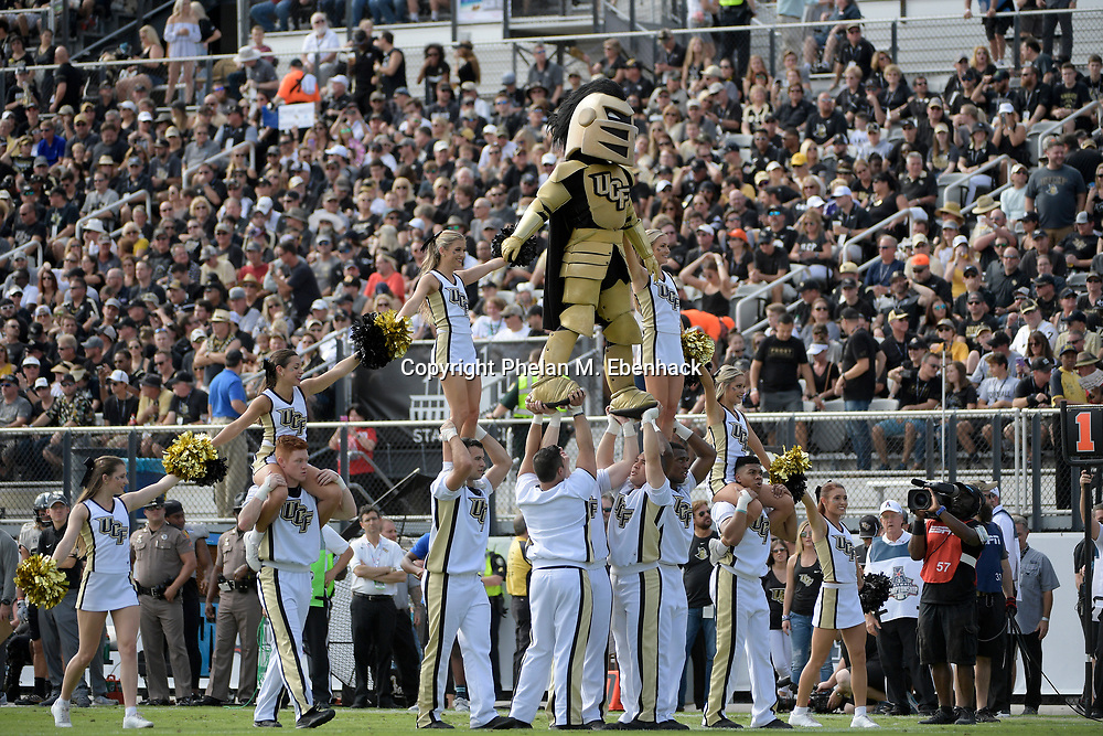 Central Florida cheerleaders perform during the first half of the American Athletic Conference championship NCAA college football game against Memphis Saturday, Dec. 2, 2017, in Orlando, Fla. (Photo by Phelan M. Ebenhack)