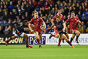Johnny McNicholl is pursued by Bill Mata during the Guinness Pro 14 2018_19 match between Edinburgh Rugby and Scarlets at BT Murrayfield Stadium, Edinburgh, Scotland on 2 November 2018.