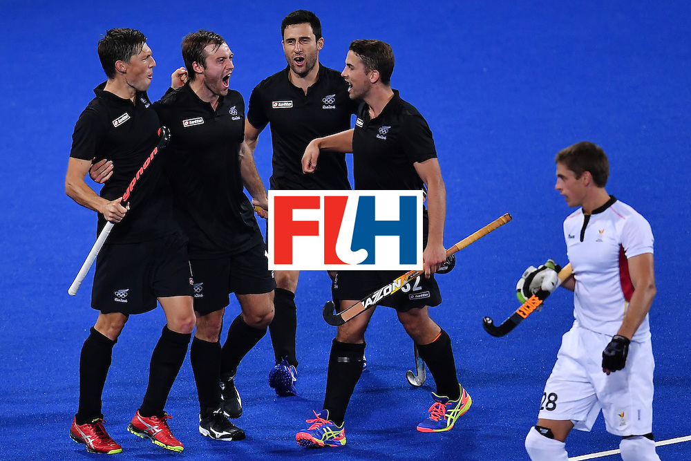 New Zealand's players celebrate scoring during the mens's field hockey Belgium vs New Zealand match of the Rio 2016 Olympics Games at the Olympic Hockey Centre in Rio de Janeiro on August, 12 2016. / AFP / MANAN VATSYAYANA        (Photo credit should read MANAN VATSYAYANA/AFP/Getty Images)