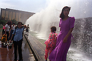 Locals enjoying the cooling fountains, during the annual Victory Day celebrations,  in Tashkent, Uzbekistan.