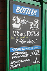Sign in front of shop selling alcoholic drinks,