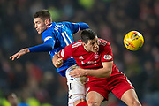 Kyle Lafferty (#38) of Rangers FC and Scott McKenna (#5) of Aberdeen FC contest a header during the Ladbrokes Scottish Premiership match between Rangers and Aberdeen at Ibrox, Glasgow, Scotland on 5 December 2018.