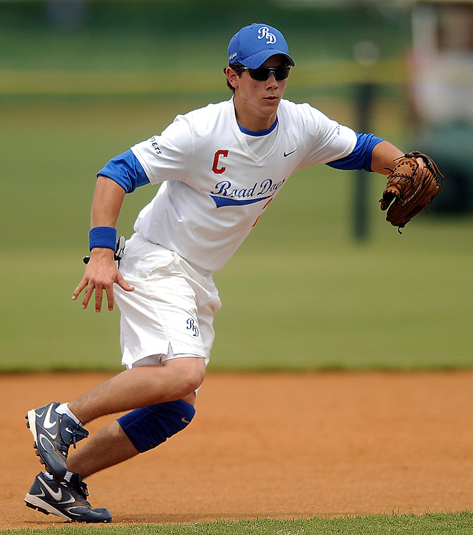 "AUGUST 19, 2009 BOCA RATON FLORIDA- Nick Jonas, of the Jonas Brothers, looks to make the catch during their softball game against the Marquis Flyers. The Jonas Brothers and their team, the ""Road Dogs"" took part in the softball game which was being held by Marquis Jet at the Saint Andrews School in Boca Raton, Fla. Marquis Jet has held 9 other softball games around the country as their company team the ""Marquis Flyers"" competes in for fun games against various teams. PHOTO BY JOSH RITCHIE"