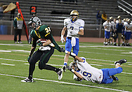 Kennedy's Trevor Heitland (33) runs 19 yards for a touchdown as he is pulled down by Wahlert's Josh Tranel (9) during the first half of the game between Cedar Rapids Kennedy and Dubuque Wahlert at Kingston Stadium in Cedar Rapids on Friday night, October 21, 2011.