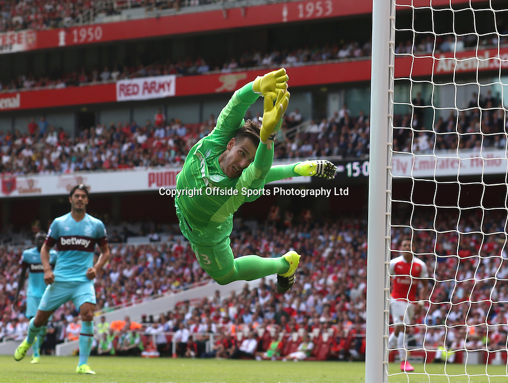 09 August 2015 Premier League Football; Arsenal v West Ham United; West Ham goalkeeper Adrian dives to make a save.<br /> <br /> Photo: Mark Leech