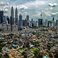 A contrasty aerial view of the underdeveloped Kampung Baru (front) against the skyline of metropolitan Kuala Lumpur, Malaysia, 21 April 2017.