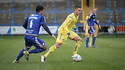 Oliver Norburn (Guiseley) runs past Hamza Bencherif (Halifax) during the Conference Premier League match between FC Halifax Town and Guiseley at the Shay, Halifax, United Kingdom on 5 December 2015. Photo by Mark P Doherty.